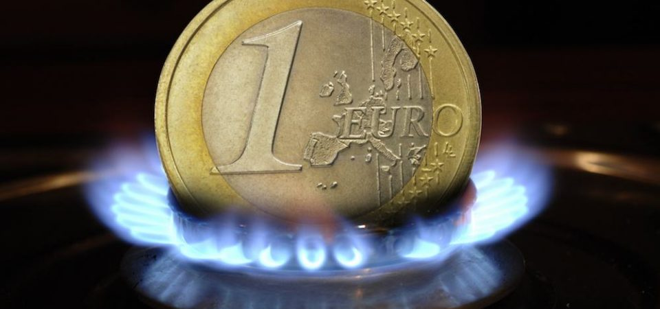 Euro coin and gas flame