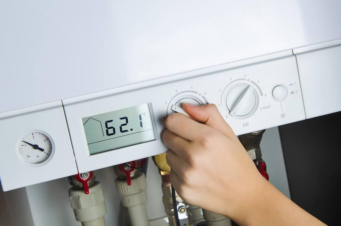 Technician servicing a natural gas boiler