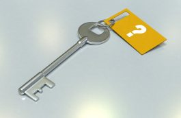 Key at the end of which a piece of paper is attached bearing question mark.