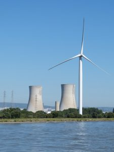 Wind and nuclear power plants on the water's edge