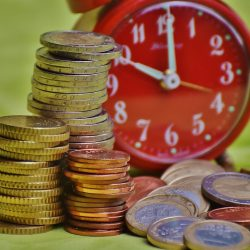 Clock and stacked euro coins