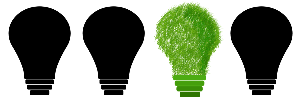 Four light bulbs, three black and one green