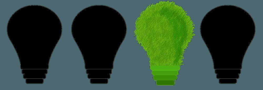Four light bulbs, three black and one green